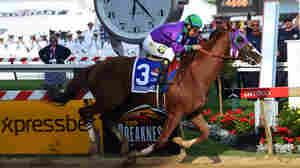 California Chrome (No. 3), ridden by Victor Espinoza, crosses the finish line to win the 139th running of the Preakness Stakes at Pimlico Race Course on Saturday in Baltimore.
