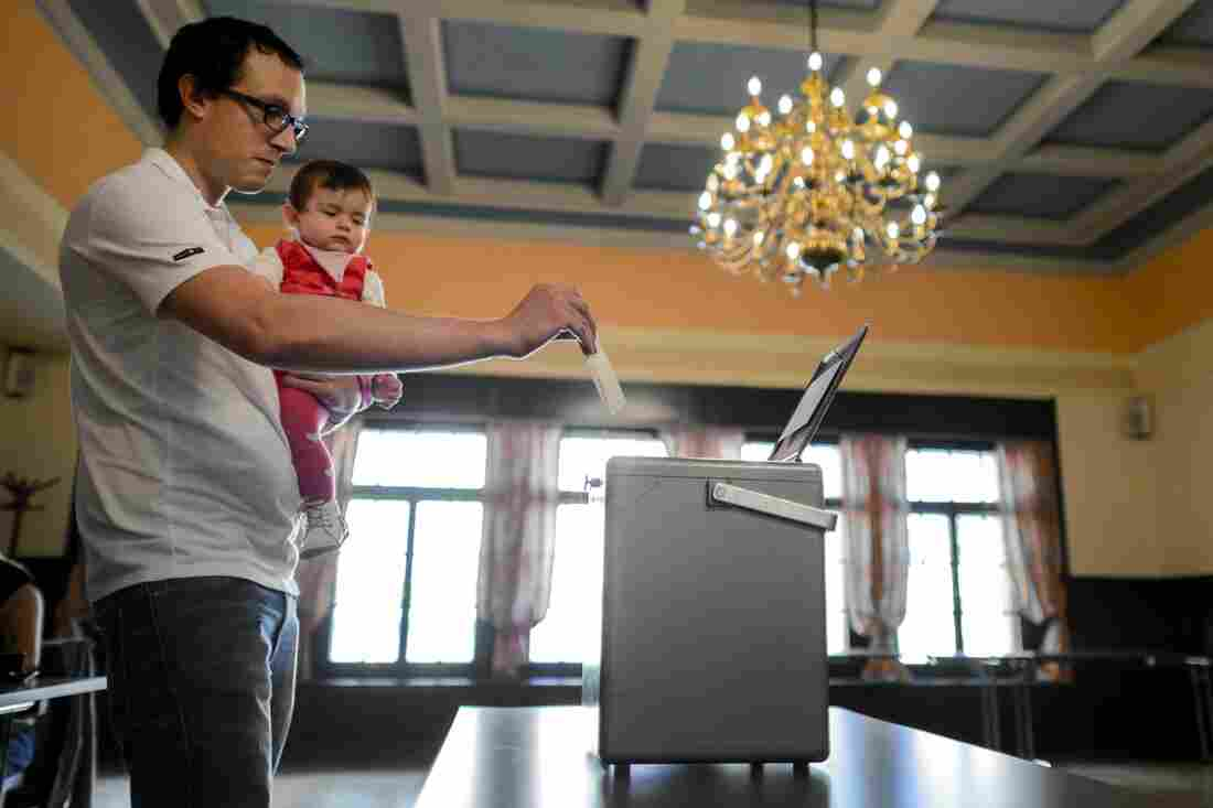 A man casts his ballot on Sunday in Bulle, western Switzerland, during a referendum.