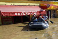 Volunteers use a rubber boat to evacuate residents from a flooded area in Obrenovac, some 18 miles southwest of Belgrade, Serbia on Sunday.