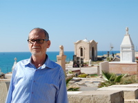 Peter Habash, an Arab Christian, stands at a Christian graveyard in Jaffa.