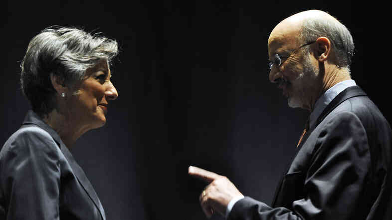 Businessman Tom Wolf talks to U.S. Rep. Allyson Schwartz before the Pennsylvania Democratic Gubernatorial Primary Debate last week in Philadelphia.
