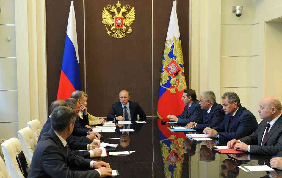 Russia's President Vladimir Putin chairs a Security Council meeting at the Bocharov Ruchei