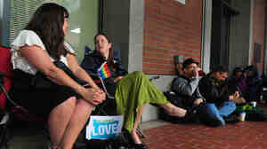 Julia Fraser (from left), Jessica Rohrbacher, Ken Brashier and Andrew Wallace await a ruling in the marriage equality case, so they can go into the building and get their marriage licenses.