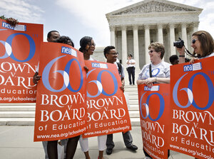 National Education Association staff members joined students, parents and educators at a rally at the Supreme Court in Washington on the 60th anniversary of the Brown v. Board of Education decision.