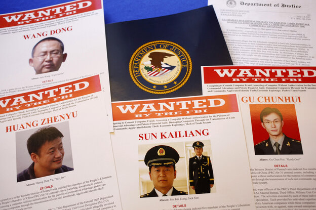 Press materials are displayed on a table at the Justice Department in Washington on Monday before Attorney General Eric Holder was to speak at a news conference.