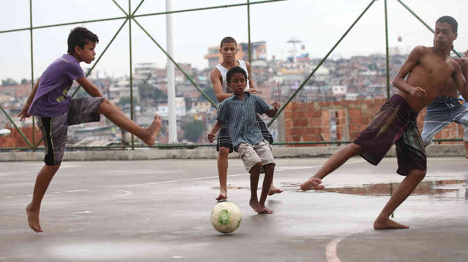 Brazilian kids play soccer in a favela, or shantytown, in Rio de Janeiro on Sunday. Brazil is hosting the World Cup next month and its team is considered the favorite. Many of the country's top players learned the game playing in the street or on dirt fields.