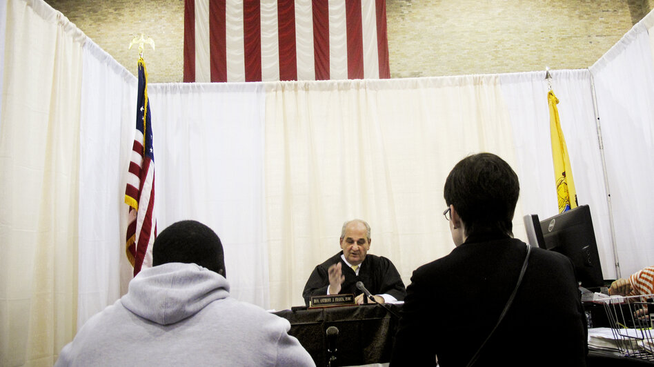The proliferation of court fees has prompted some states, like New Jersey, to use amnesty programs to encourage the thousands of people who owe fines to surrender in exchange for fee reductions. At the Fugitive Safe Surrender program, makeshift courtrooms allow judges to individually handle each case.