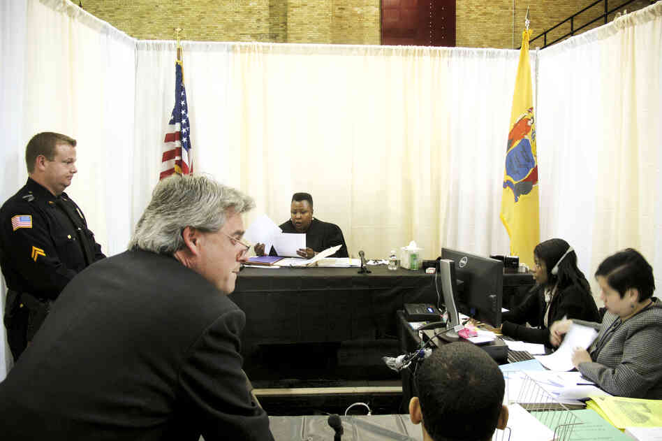 Makeshift courtrooms were set up inside the armory for judges to review each case.