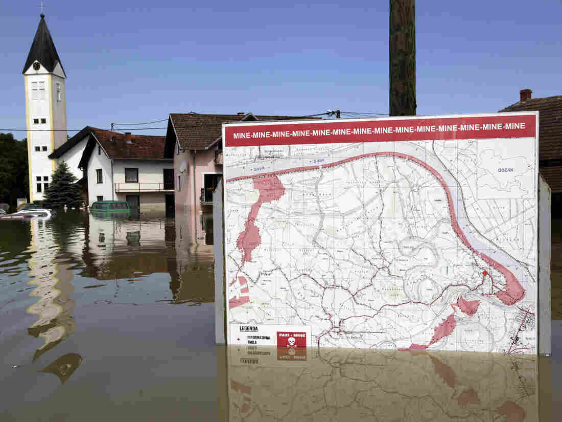 A map showing a land mine field is seen in the water during heavy floods in the village of Prud, Bosnia and Herzegovina, on Tuesday.