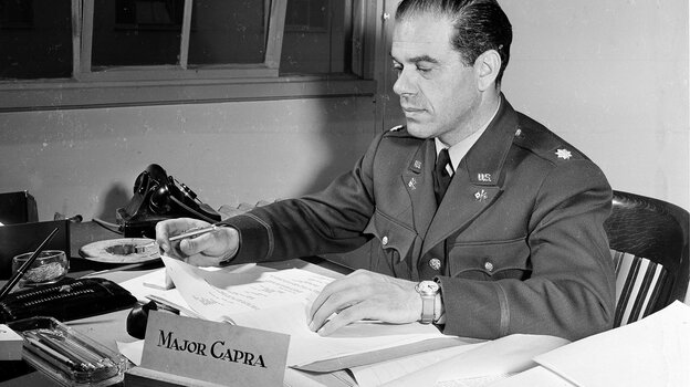 Maj. Frank Capra sits at his War Department desk in Washington on March 6, 1942. Capra's non-War Department films include It's A Wonderful Life and Mr. Smith Goes To Washington.