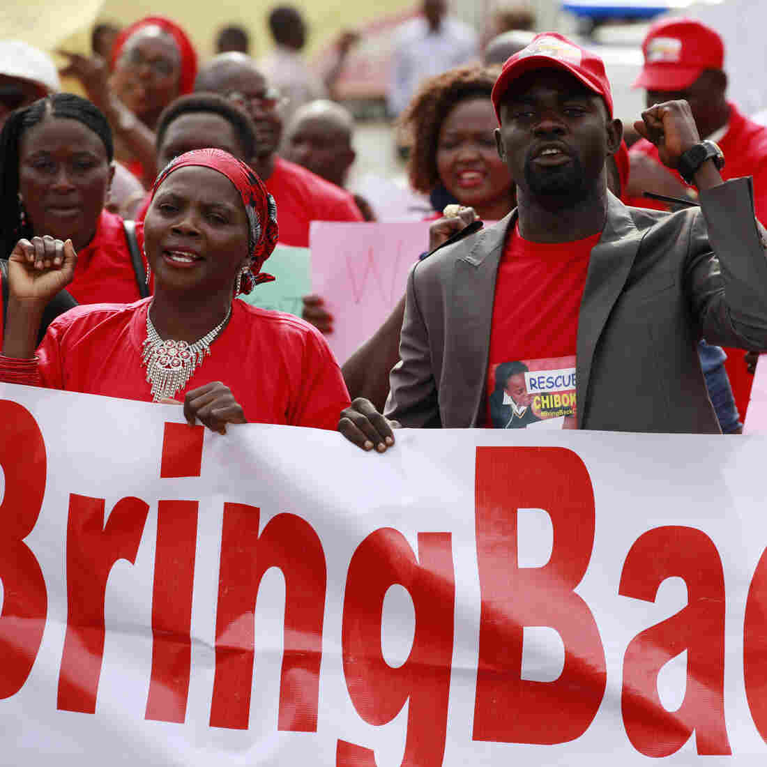 People attend a rally in Abuja, Nigeria, calling on the government to rescue kidnapped school girls.