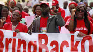 Relatives Of Kidnapped Girls: Bring Them Back — But Alive