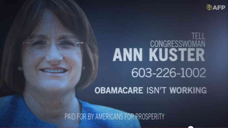 A frame grab image from video provided by Americans for Prosperity shows a political ad