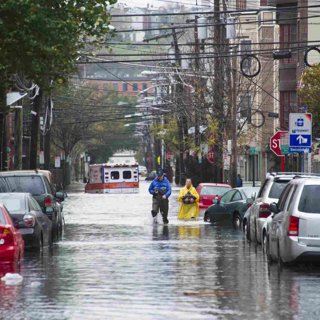 Hoboken, N.J., residents walk through flood water in the aftermath of Hurricane Sandy. Mayor Dawn Zimmer is advocating for better planning and increased funding for flood-prone urban areas.