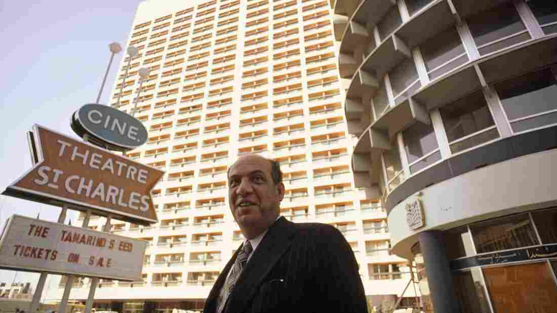 The Beirut Holiday Inn rises behind the man who built it, Abdal Mohsin Kattan, in 1975. The Holiday Inn was one of the leading hotels in Beirut at a time when it was the most glamorous city in the Middle East. But when the Lebanese civil war broke out in 1975, the hotel was fiercely contested by rival militias. Lebanese are still debating what to do with the building.