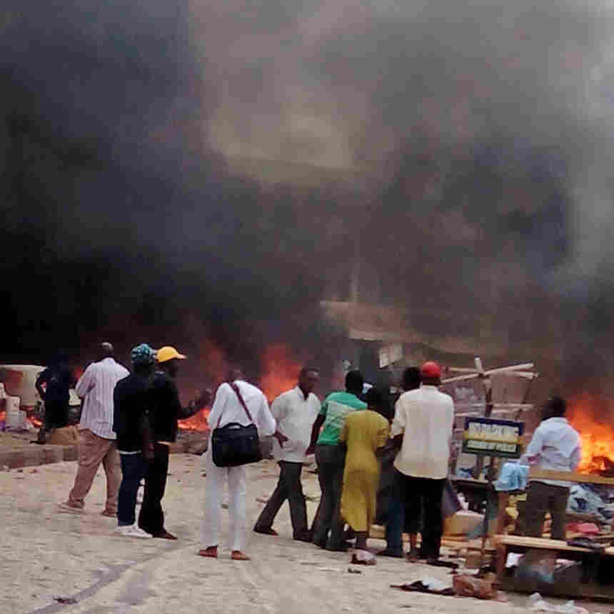 Smoke rises after a bomb blast at a bus terminal in Jos, Nigeria, on Tuesday.
