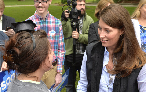 Alison Lundergan Grimes, the Democratic nominee for a Senate seat from Kentucky, talks with recent college graduate Lee Fowler during a May 17 campaign stop.