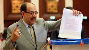 Iraqi Prime Minister Nouri al-Maliki votes in Baghdad on April 30. Maliki's alliance won the most seats in election results announced this week. But his party will still have to build a coalition with rival parties for him to keep the job he's had for the past eight years.