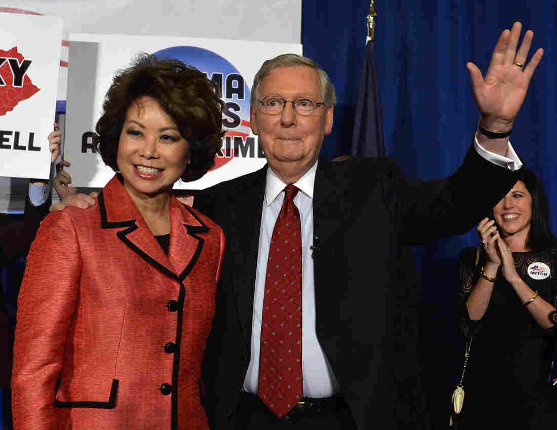 Sen. Mitch McConnell, R-Ky., and his wife, Elaine Chao, wave to supporters in Louisville following his GOP primary victory on Tuesday.