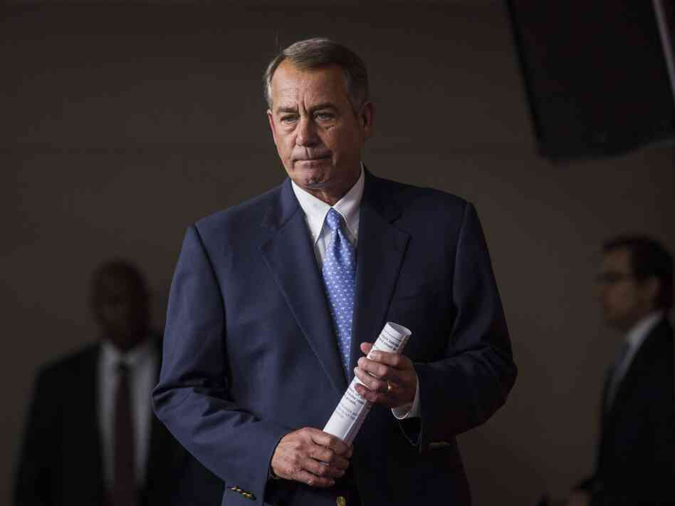 Speaker John Boehner prepares to speak to the media after the House passed the USA Freedom Act, an NSA reform bill aim