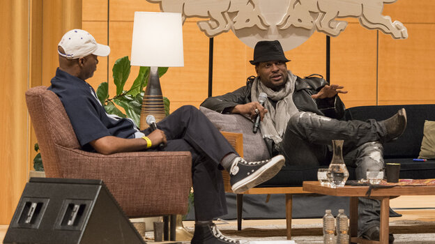 D'Angelo with Nelson George (left) onstage at the Brooklyn Museum Wednesday night.