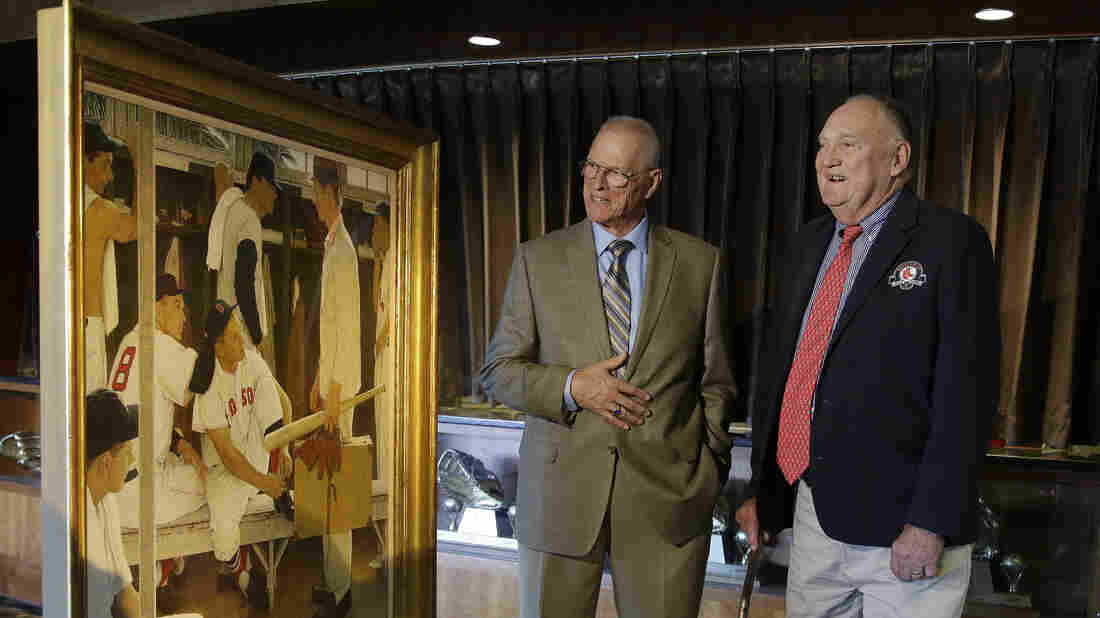 Two of the men who posed for Norman Rockwell's The Rookie — Frank Sullivan (right), the player with 8 on his back in the painting, and Sherman Safford, the rookie holding the suitcase — viewed the work at Fenway Park earlier this month. The painting was sold at auction Thursday.
