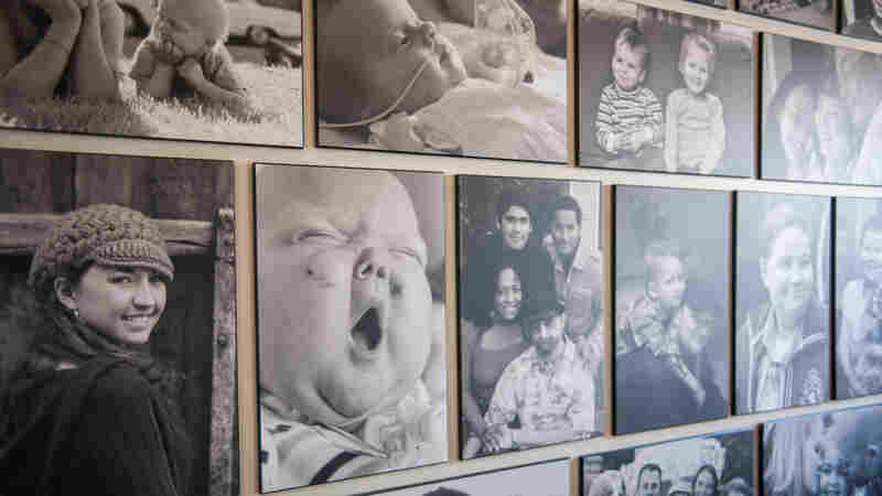 Children's faces line the wall of Soulumination in Seattle. The non-profit is a collection of photographers who volunteer their time to document families with children who are stillborn or terminally ill.