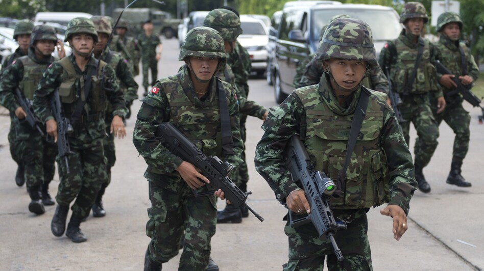 Thai soldiers patrol after army chief Gen. Prayuth Chan-ocha announced that the armed forces were seizing power after months of political turmoil. (Pornchai Kittiwongsakul/AFP/Getty Images)