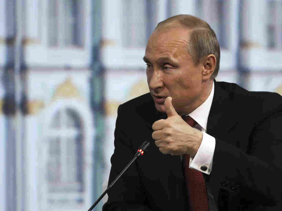 Russia's President Vladimir Putin speaks during a session of the St. Petersburg International Economic Forum 2014 in St. Petersburg on Friday. He told the audience that he would respect Sunday's presidential vote in Ukraine.