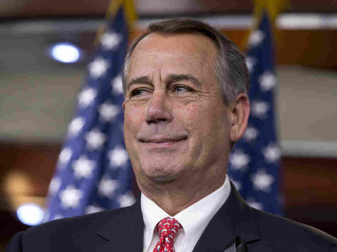 During a December news conference, House Speaker John Boehner rebukes conservative groups who opposed the bipartisan budget compromise.
