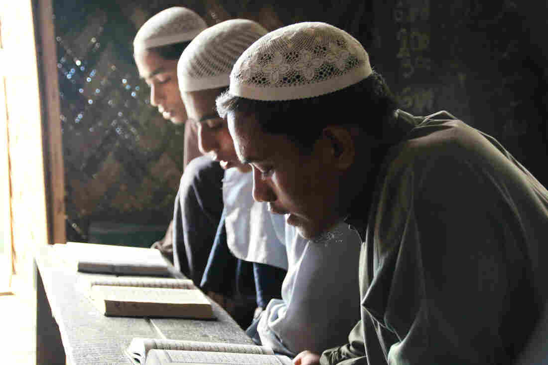 Rohingya students recite from the Quran at a madrassa, or Islamic school, outside Sittwe. About 70 percent of the students at the madrassa are internally displaced persons. Their options for education are limited, and Sittwe University stopped admitting Rohingya students after 2012.