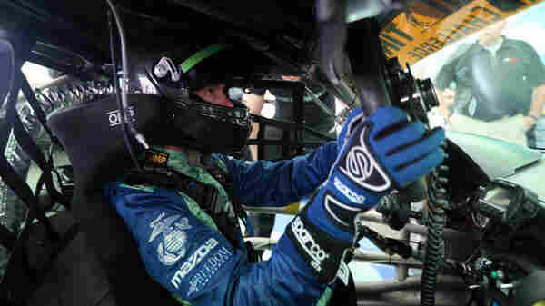 Liam Dwyer makes adjustments before his professional racing debut with Freedom Autosport at Mazda Raceway Laguna Seca.