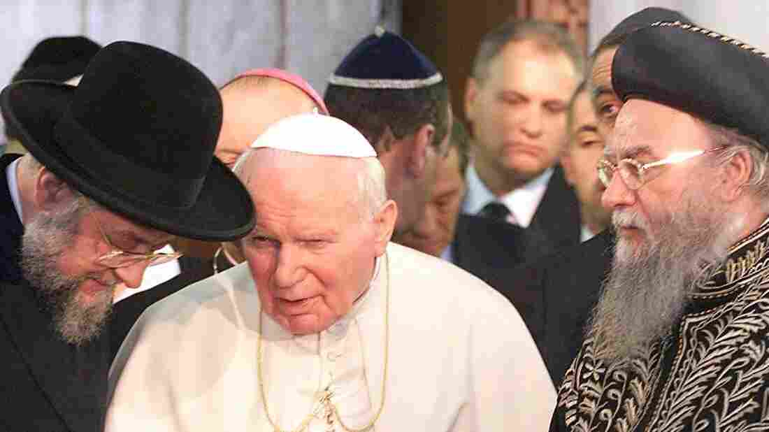 Pope John Paul II speaks to Israel's two head rabbis, Meir Lau (left) and Eliahu Bakshi-Doron (right), during his visit to Jerusalem in 2000. The pontiff reached out to both Jews and Muslims on his trip and was warmly embraced. His successors as pope, Benedict XVI and Francis, have also visited the Holy Land.