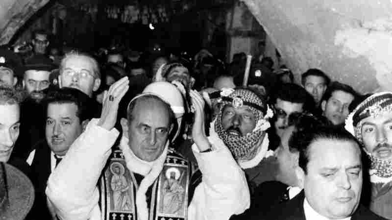 Pope Paul VI is greeted by a cheering crowd in Jerusalem's Old City on Jan. 4, 1964. Despite the city's central role in Christianity, Paul VI was the first pope to visit Jerusalem.