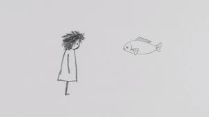 Xiangjun Shi stares at a fish.