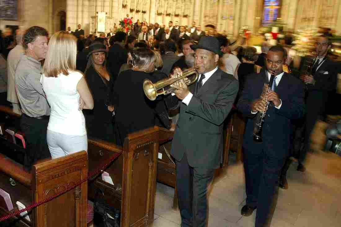 Wynton Marsalis leads a group of musicians through upper Manhattan's Riverside Church for the New Orleans-style funeral of vibraphonist Lionel Hampton in 2002.