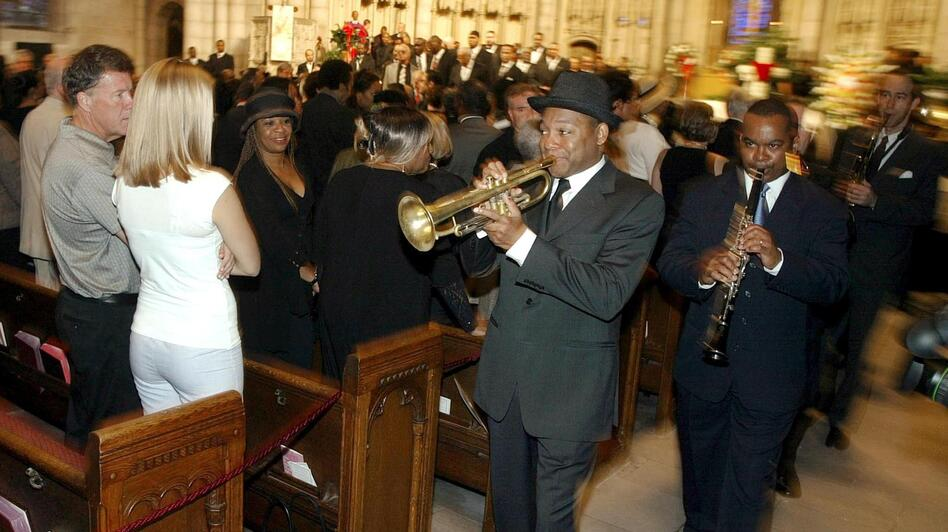 Wynton Marsalis leads a group of musicians through upper Manhattan's Riverside Church for the New Orleans-style funeral of vibraphonist Lionel Hampton in 2002. (AFP/Getty Images)