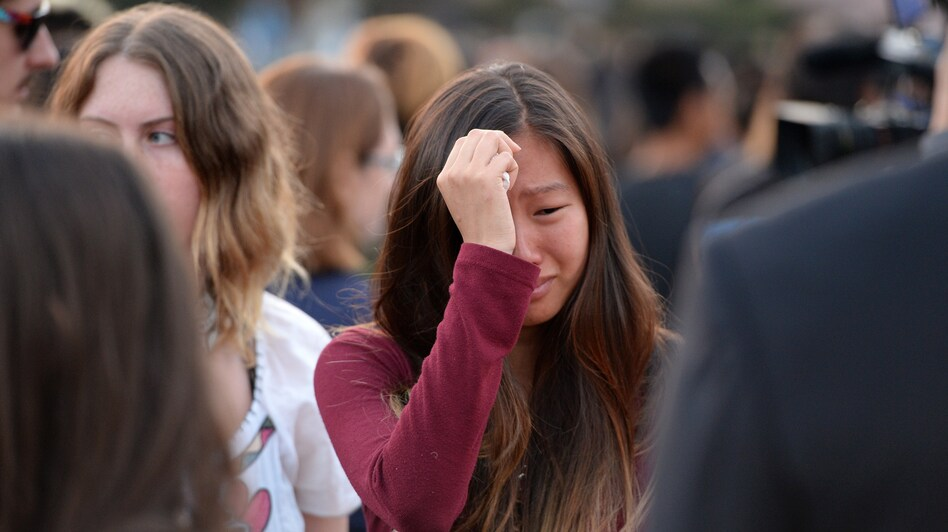 A student weeps during a candlelight vigil on Sunday for the victims of a killing spree in Isla Vista, on the University of California, Santa Barbara campus. (AFP/Getty Images)