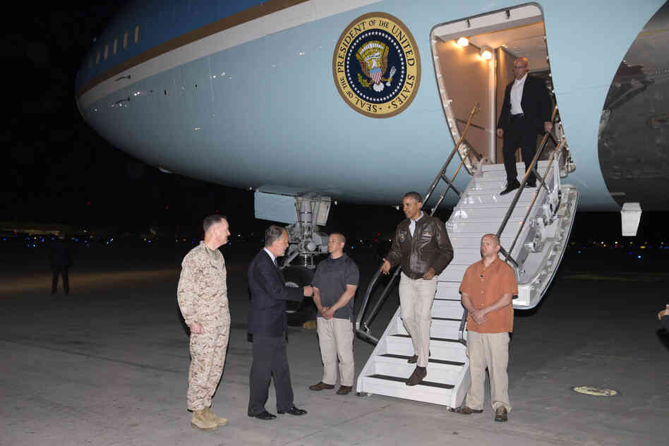 President Barack Obama is greeted by U.S. Ambassador to Afghanistan James Cunningham and Marine General Joseph Dunford, commander of the U.S.-led International Security Assistance Force (ISAF), as he steps off Air Force One at Bagram Air Field in Afghanistan.