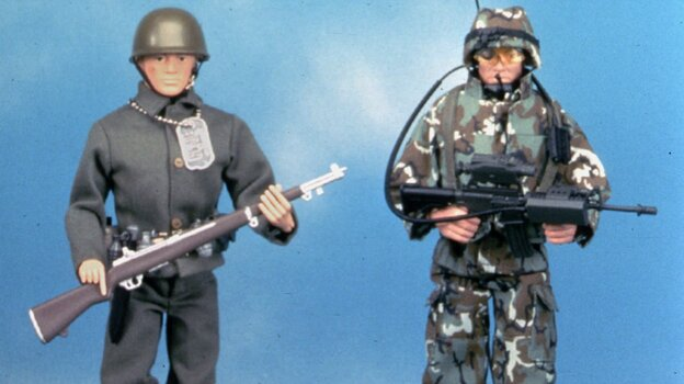 At left is a reproduction of the original G.I. Joe action figure made in 1964. The doll on the right is a newer G.I. Joe model. Has
