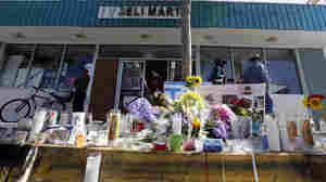 A makeshift memorial sits in front of IV Deli Mart, where part of Friday night's mass shooting took place in the Isla Vista, Calif., community. The parents of Elliot Rodger, accused of killing six people, were reportedly rushing to try to stop their son when they heard about the violence.
