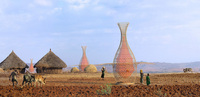 The WarkaWater gathers water from fog and condensation. Named after an Ethiopian fig tree, it consists of a 30-foot bamboo frame and a nylon net. It was invented by an Italian firm and three of them are shown here in an Ethiopian village.