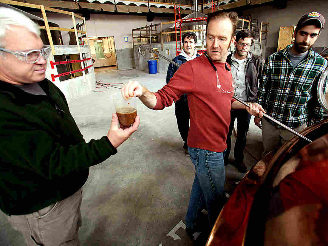 John Stuart (left) of Green Man Brewery grabs a Tater Ridge mash sample from Sierra Nevada's Scott Jennings (center) at the Sierra Nevada brewery in Mills River, N.C.