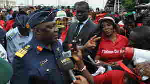 Nigeria's chief of defense staff Air Marshal Alex S. Badeh speaks during a demonstration in Abuja calling for the rescue of girls kidnapped from their school in Chibok. Badeh says the government knows where the girls are — but that a rescue attempt would endanger their lives.