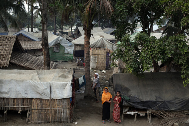 Muslim Rohingya women are pictured at the Thae Chaung camp for internally displaced people in Sittwe, Myanmar, on April 22. The stateless Rohingya in western Myanmar have been confined to the camps since violence erupted with majority Buddhists in 2012. The camps rely on international aid agencies, but still lack adequate food and health care.