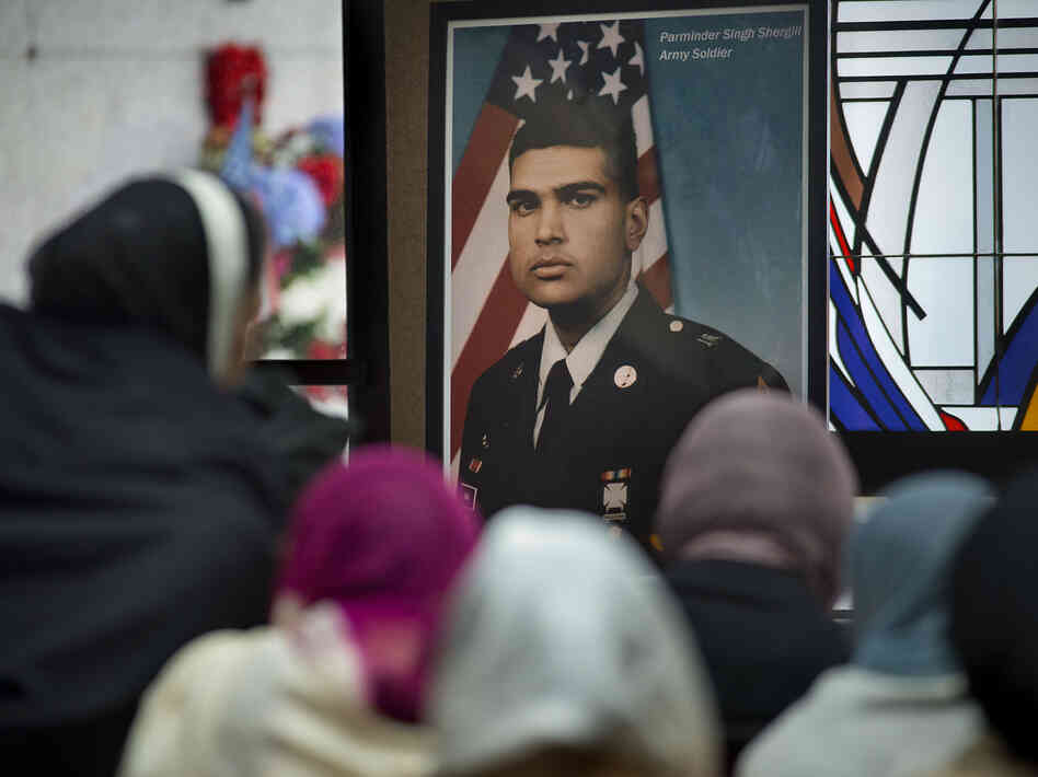 A photograph of Parminder Singh Shergill is displayed during his funeral services at Cherokee