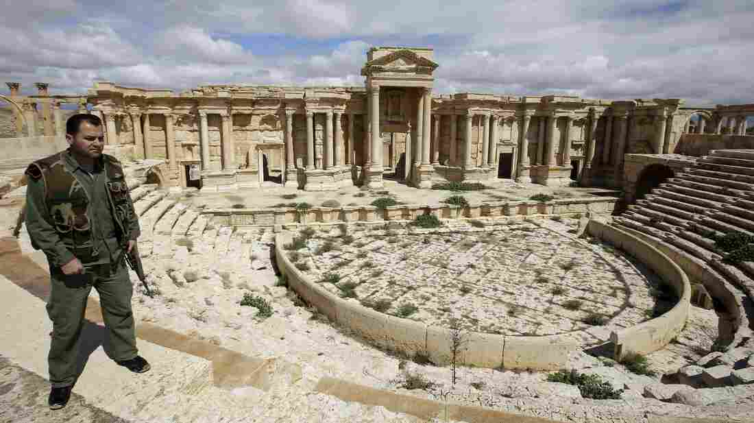 A Syrian policeman patrols the ancient oasis city of Palmyra in March. Many Syrian antiquities have been looted and smuggled out of the country during the past three years of civil war.