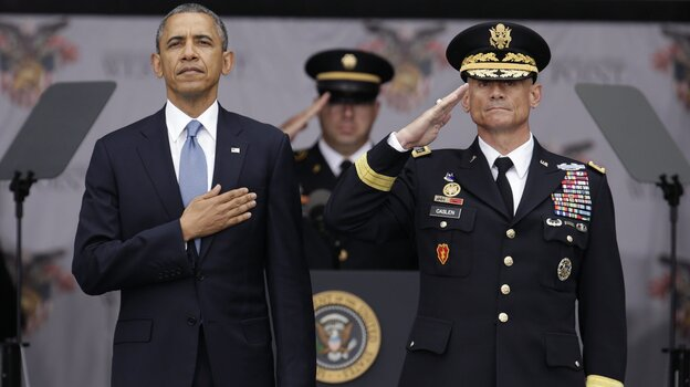 President Obama and superintendent of the Military Academy, Lt. Gen. Robert L. Caslen Jr., take the Pledge of Allegiance at the West Point graduation ceremony on Wednesday. In an interview with NPR, President Obama said U.S. foreign policy should focus more on diplomatic efforts than on large-scale military operations.
