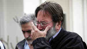 Richard Martinez, whose son Christopher Michael-Martinez was killed in Friday's mass shooting in Isla Vista, Calif., breaks down as he talks to media outside the Santa Barbara County Sheriff's headquarters on Saturday.