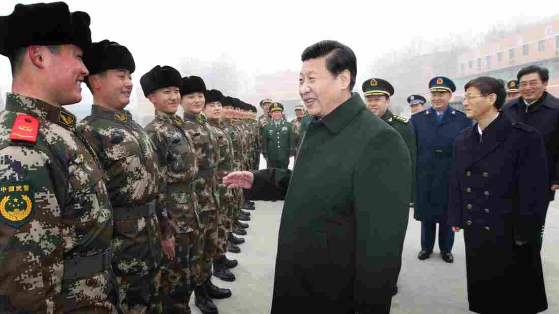 Chinese President Xi Jinping (center) talks with members of the Chinese People's Armed Police Force in Beijing. China has been increasingly assertive in Asia, and many U.S. allies want the U.S. to have a strong presence in the region as a counterbalancing force.